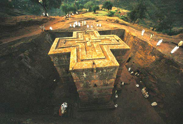 Church of St. George in Lalibela, Ethiopia was hewn from the living rock of monolithic blocks in the 12th century.  These blocks were further chiselled out, forming doors, windows, columns, various floors, roofs etc. This gigantic work was further completed with an extensive system of drainage ditches, trenches and ceremonial passages, some with openings to hermit caves and catacombs.
