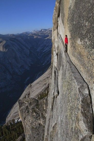 I understand why this person is standing with his back against the wall, looking terrified.  What I don't understand is how and especially WHY he put himself there.   This 40-foot-long sliver of granite is on Half Dome in Yosemite National Park, in California.