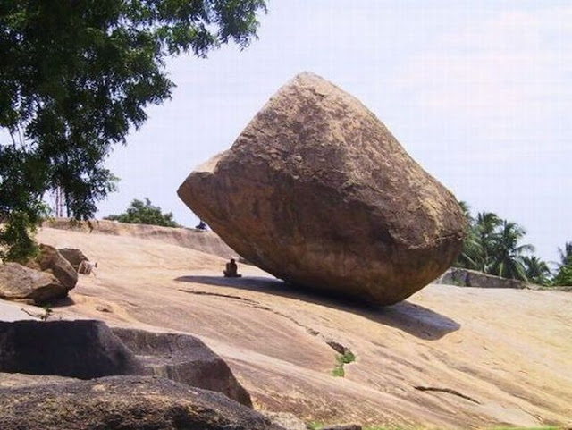 It's not just cliffs that make me squeemish.  I'd never sit under this boulder.  Would you?