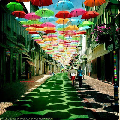 Umbrellas provide shade on street in Portugal