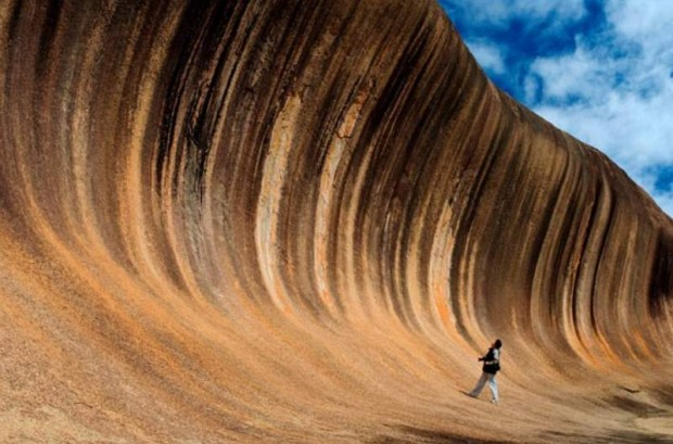 The Wave on Hyden Rock, Australia, a giant surf wave of multicoloured granite about to crash onto the bush below. From over 2,700 million years ago, before dinosaurs roamed the earth!