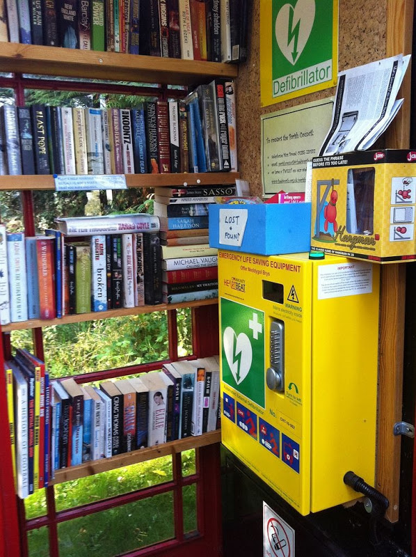 This telephone booth library includes a defibrilator