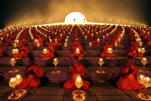 Buddhist monks lantern-lighting ceremony