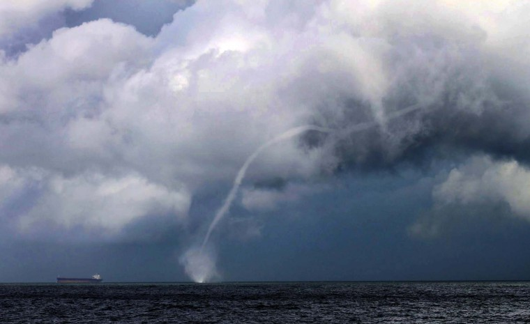 Water spouts are columns of rotating air also known as tornadoes over water. They usually develop over warm tropical ocean waters. The size can range from just a few feet, to several hundred feet wide.