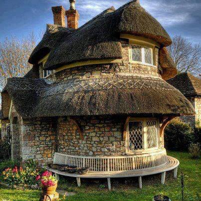 A rubble stone lime mortar thatched cottage in Blaise Hamlet near Bristol, England