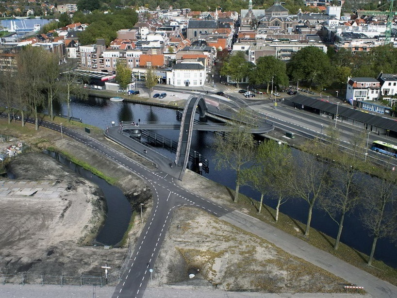 Architects from NEXT were chosen to design a new bridge over a canal in Purmurend, The Netherlands to accommodate bikes, pedestrians and wheelchairs. However, wheelchairs need very shallow ramps for access, which made the bridge a really long Z shape, almost 330 feet long.