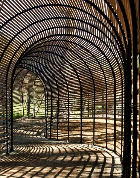 Puff Adder is a wooden tunnel resembling a snake used for growing lilies in South Africa, architects by Patrice Taravella and Terry de Waal.