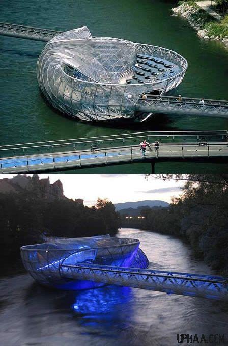 Aiola Island Bridge - Mur River in Graz, Austria - It has a sunbathing area, a trendy bar and a coffee house, plus it allows you to cross the Mur River