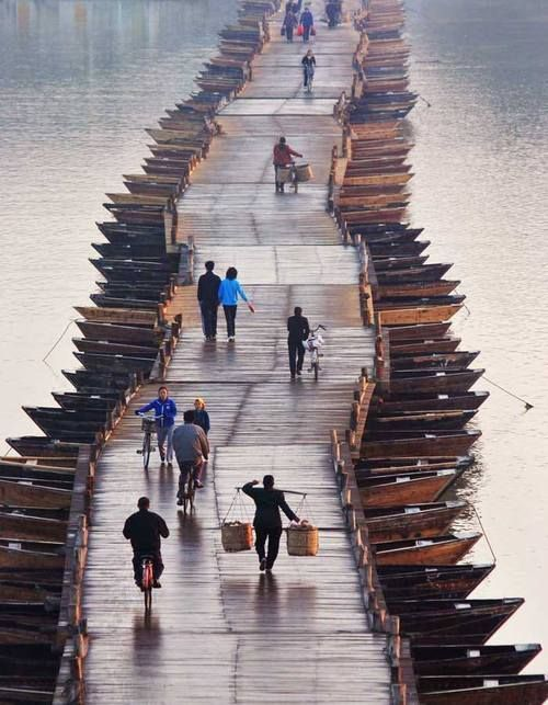 The whole bridge is suspended with boats holding planks together, China