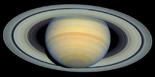 Taken by Hubble telescope in March 2003, Saturn's rings are shown at maximum tilt toward Earth, occurring only every 15 years.