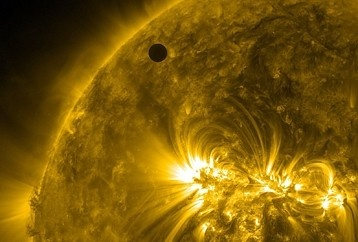 Venus starting to cross in front of the sun, from NASA via Washington Post.