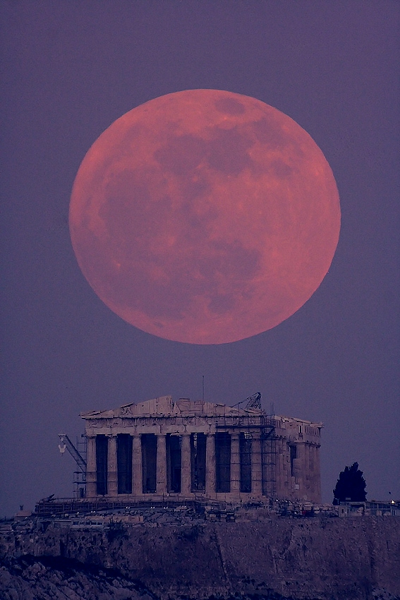a Super Moon, the biggest moon in 20 years, shown here above the Parthenon in Greece.