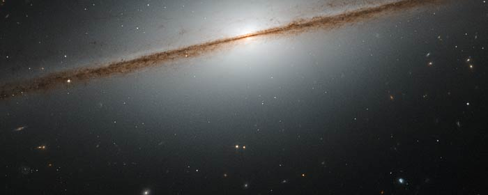 A spiral galaxy with image taken directly from its edge, via Hubble telescope.
