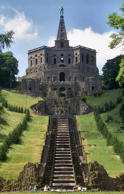 Wilhelmshöhe Castle (formerly Karlsberg) was built in 1696. It occupies an entire hillside in the city of Kassel, Germany. The crown of the hill is the gigantic 'grotto' topped by the sculpture of Hercules.