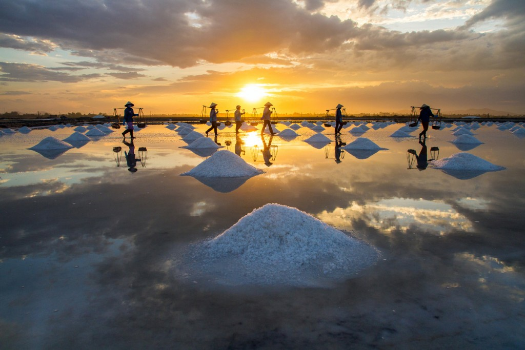 People Harvesting Salt at Sunset, Khanh Hoa Province, Vietnam by Hoang Giang Hai