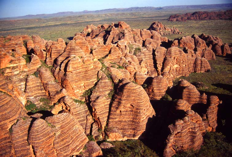 The unique orange, grey and black stripes of the Bungle Bungle range are the result of alternating bands of sediment, each with different clay content. Deposited in the Ord Basin 375 – 350 million years ago, the effects of wind from the desert and rainfall over millions of year shaped the domes. Photo by Paddy Ryan.
