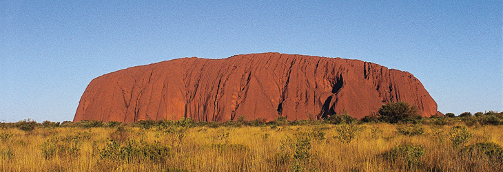 Uluru, or Ayers Rock, is a massive sandstone monolith in the heart of the Northern Territory's Red Centre desert, 450km from the nearest large town, Alice Springs. It's sacred to indigenous Australians and believed to be about 700 million years old.
