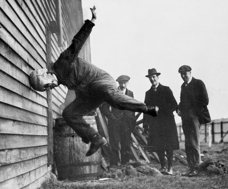 Testing football helmets in 1912.