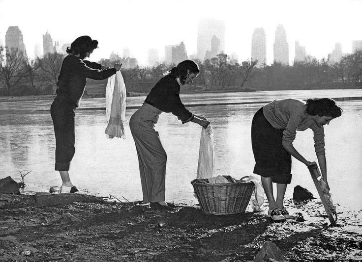Three young women wash their clothes in Central Park during a water shortage. New York, 1949.