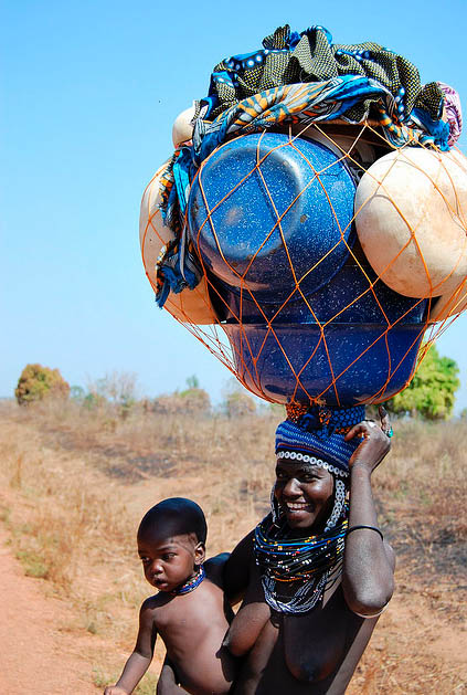 This is a common way to transport goods in Burkina Faso, Africa.