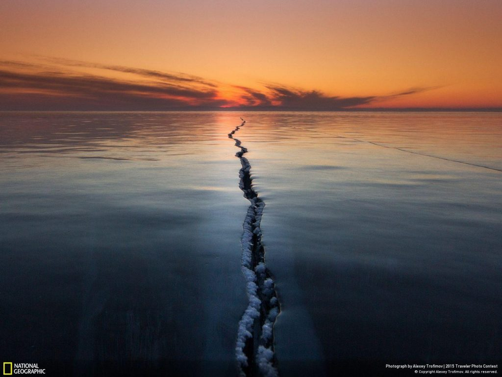 Russian Alexey Trofimov captured this image of cracks hundreds of yards long in the ice of Lake Baikal, the world's largest freshwater lake in Siberia.