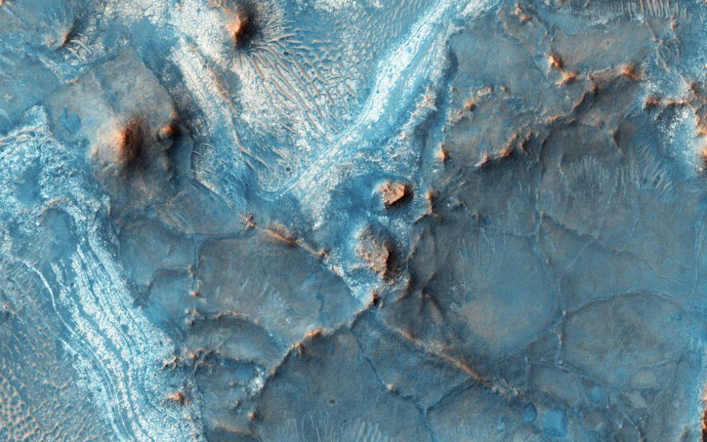 The Nili-Fossae region located on the northwest rim of Isid impact basin is one of regions of Mars.