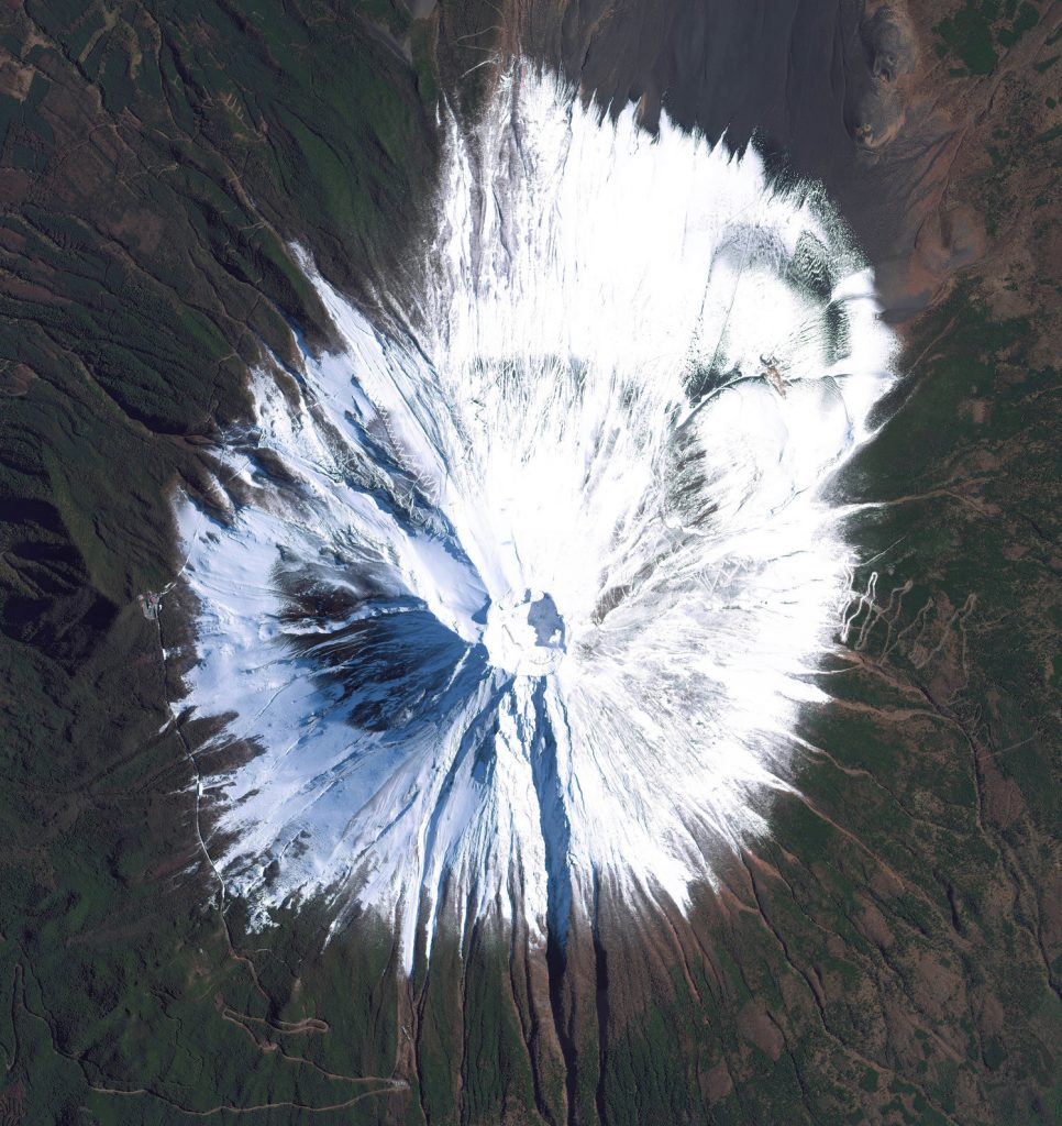 Mount Fuji is an active volcano and the tallest peak in Japan, rising 3,776 meters (12,389 feet). As seen in this Overview, Fuji has an extremely symmetrical cone, which is snow capped several months of the year.