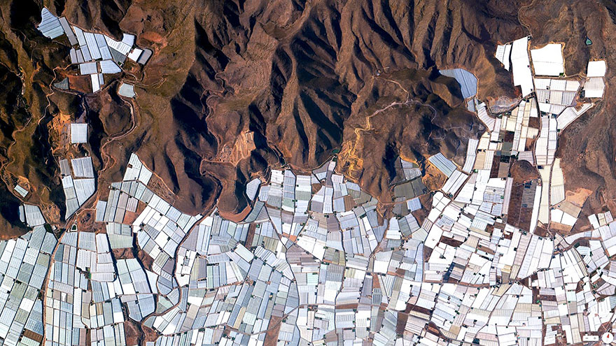 Plasticulture refers to the practice of using plastic materials in agricultural applications. This is visible in the plains and valleys of Almeria, Spain where nearly 20,000 hectares (about 50,000 acres) are covered by these greenhouse structures.