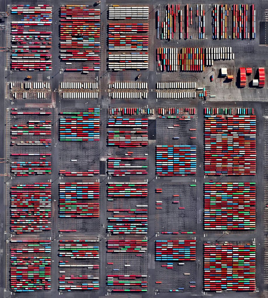 Shipping containers are stacked at the Port Newark Container Terminal in Newark, New Jersey, USA. The massive facility handles over 600,000 shipping containers every year and has begun expansion projects that will increase annual capacity to 1.1 million containers by 2030.