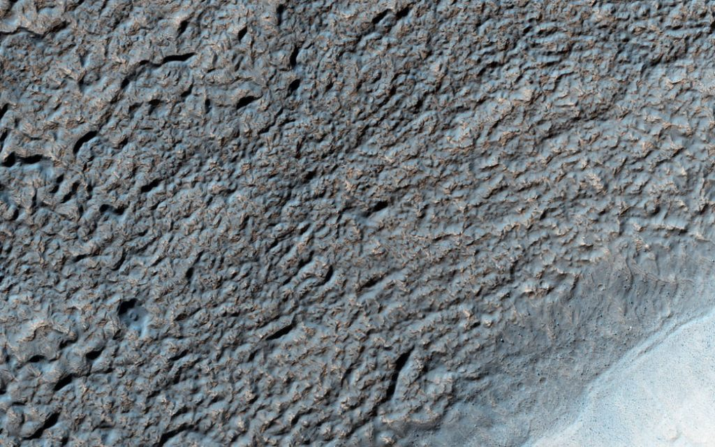 This image of Solis Planum — a huge mound south of the Mars canyon system Valles Marineris - was acquired by the HiRISE camera on NASA's Mars Reconnaissance Orbiter on Aug. 16, 2015, at 2:47 p.m. local Mars time.