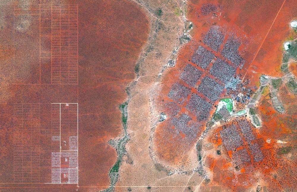 Hagadera, seen here on the right, is the largest section of the Dadaab refugee camp in northern Kenya and is home to 100,000 refugees. To cope with the growing number of displaced Somalis arriving at Dadaab, the UN has begun moving people into a new area called the LFO extension, seen on the left. Dadaab is the largest refugee camp in the world with an estimated total population of 400,000.