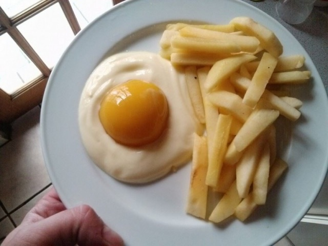 Wholesome breakfast: Yogurt, a peach and an apple.